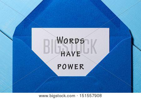 Words have power - inscription written on letter at blue envelope.
