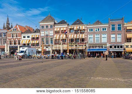 Delft, Netherlands - April 4, 2008: Tourists Walk In Central Square Surrounded By Old Homes