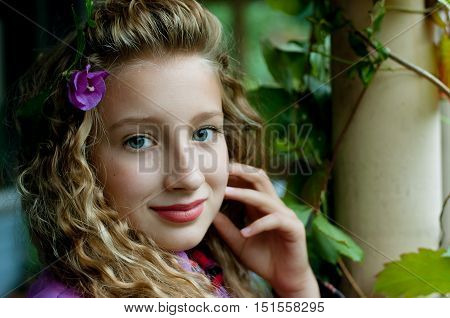 portrait of a beautiful girl outdoors in autumn
