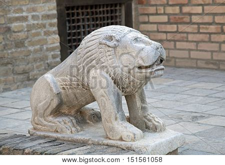 Statue of a lion in asian style, Uzbekistan
