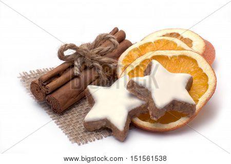 Cinnamon stars with orange slices and cinnamon sticks isolated