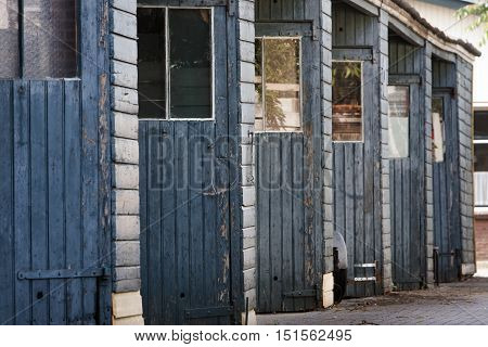 Vintage blue sheds in a row in the Lansink district in Hengelo in the Netherlands