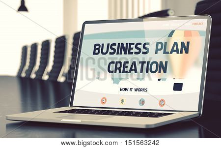 Modern Meeting Room with Laptop on Foreground Showing Landing Page with Text Business Plan Creation. Closeup View. Blurred Image with Selective focus. 3D Illustration.