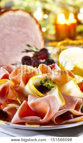 Pork ham on wooden plate thin slices with cheese