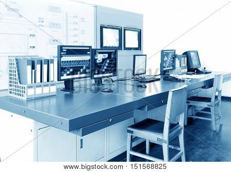 Computer control room technology industry arranged on the desktop monitor.