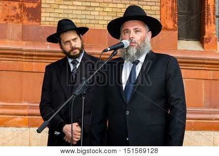 Uzhgorod Ukraine - October 9 2016: The Rabbis read the prayer at the opening ceremony of the monument to local victims of the Holocaust on the square near the former synagogue.