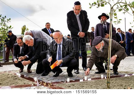 Uzhgorod Ukraine - October 9 2016: Participants in the opening ceremony of the monument to local victims of the Holocaust ignited candles on the square near the former synagogue.