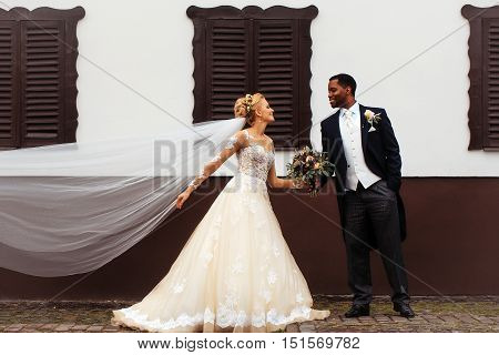 Bride And Groom Hold Bouquet