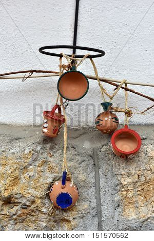 Hanging Clay Jugs And Cups On The Wall