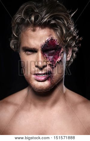 Beautiful man with a naked with blood on his face