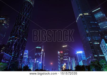 GUANGZHOU CHINA - OCTOBER 4: Dusk view of the Flower Square and modern skyscrapers in Guangzhou downtown China on Octover 4 2016.
