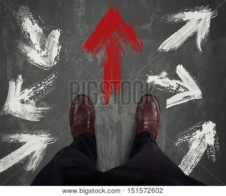 Businessman decided direction and follows the red arrow
