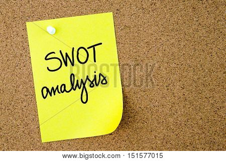 Swot Analysis Text Written On Yellow Paper Note