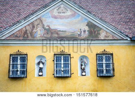 Religious fresco and figurines on a church in Krems Austria