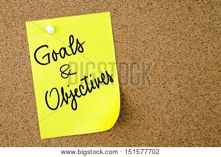 Goals And Objectives Text Written On Yellow Paper Note