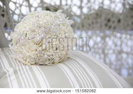 Close Up Of Wedding Bouquet With Brooches