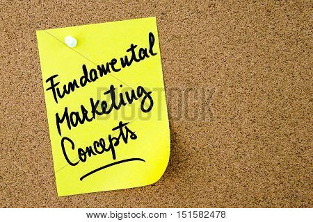 Fundamental Marketing Concepts Text Written On Yellow Paper Note