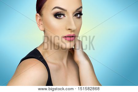 Beautiful caucasian girl with looking at the camera photographed in the studio