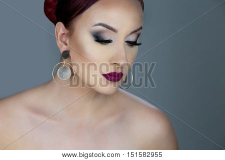Beautiful caucasian girl with green hair looking at the camera photographed in the studio