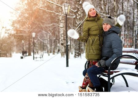 couple in love on a street winter snow