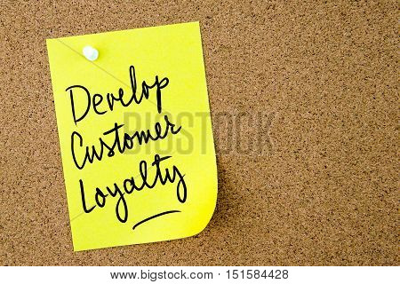 Develop Customer Loyalty Text Written On Yellow Paper Note