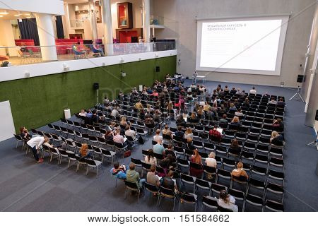 Moscow, Russia - September 3, 2016: People attend Digital Marketing Conference in big hall of Mail.ru internet company. Top view