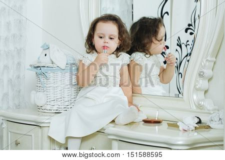 Adorable Little Girl In Front Of The Mirror