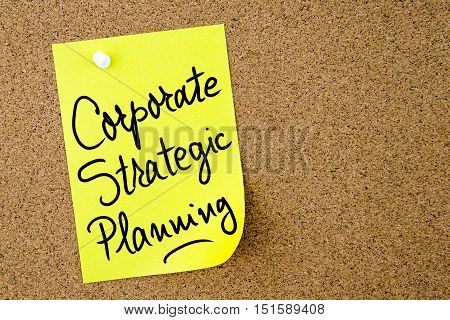 Corporate Strategic Planning Text Written On Yellow Paper Note