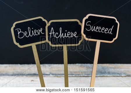 Motivational Message Believe, Achieve, Succeed Written With Chalk
