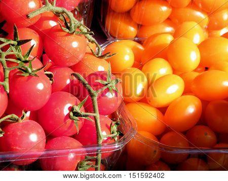 Red and yellow tomatoes on bazaar in Tel Aviv IsraelJanuary 7 2011