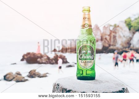 KHAI NAI ISLANDTHAILAND-OCTOBER 8 2016: The New Chang Beer Bottle on wood chair on the beach Thai people like to drink Thailand's largest and one of Southeast Asia's largest beverage companies
