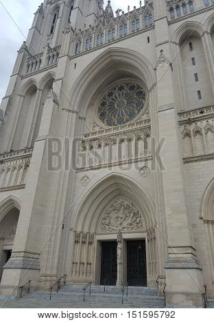 Washington DC, USA - September 17, 2016 - The portal of the Cathedral Church of Saint Peter and Saint Paul in the City and Diocese of Washington, known as The National Cathedral, with architectural and sculptural neo-Gothic details.