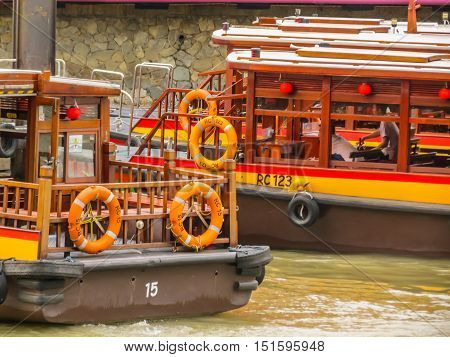 SINGAPORE, REPUBLIC OF SINGAPORE - JANUARY 10, 2014: Historical quay on the Singapore River. Moored ships on the pier. Clarke Quay, Singapore