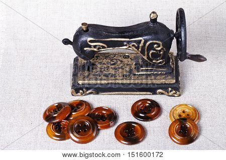 a Vintage sewing machine and wooden buttons