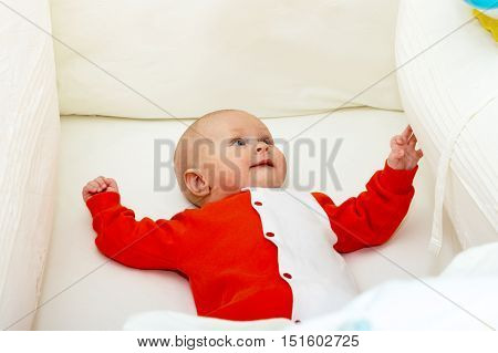 Close up shot of boy newborn in cot