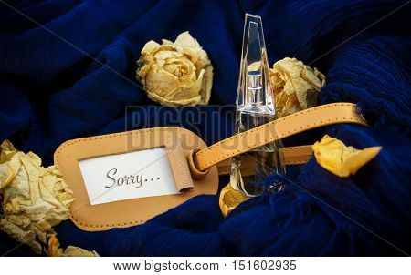 Bottle On A Blue Background, Words On Paper