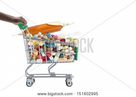 Hands pushing supermarket trolleys filled with pills and medicinal treatment