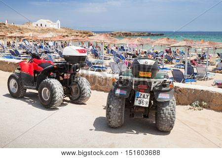 Atv Quad Bikes Stand Parked Near Beach