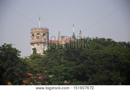 An European style castle building on the coast of Qingdao China in Shandong province on a hazy sunny day.