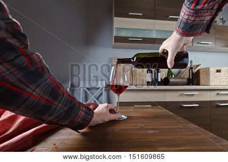 Sommelier Pouring Red Wine Into A Glass