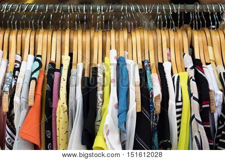 close up of beside colorful fashion cloth hanging on hangers.