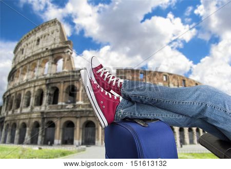 relaxed person with feet above the suitcase on arrival in Rome