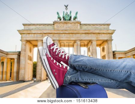 relaxed person with feet above the suitcase on arrival in Berlin