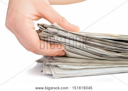 hand taking the pile of newspapers for recycling on white background