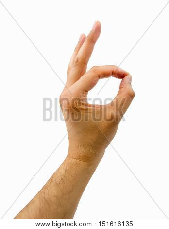the hand of man gesturing OK on white background