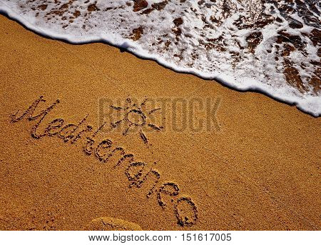 Mediterranean sign on the sand beach of Barcelona