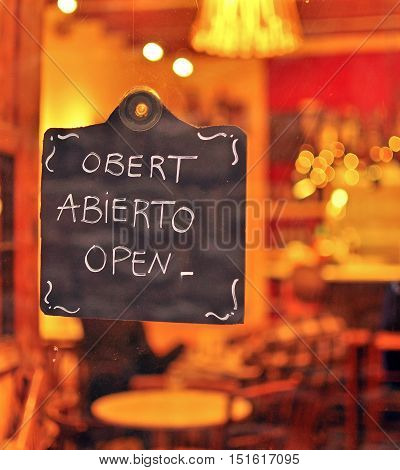 Open sign in english catalan and spanish languages