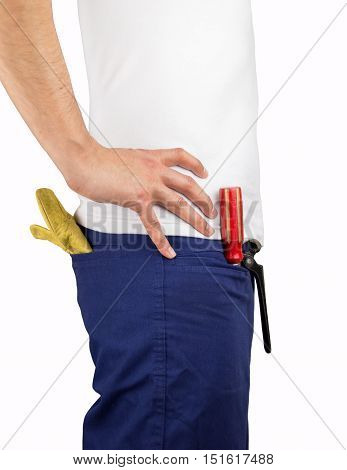 profile of building worker with tools in the pockets and hands on the hip over white background