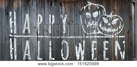 Happy Halloween banner. Greeting lettering on the old fence. Horizontal banner with sinister pumpkins. Cracked paint and old fence texture. Realistic 3d illustration. Design template. Modern style.
