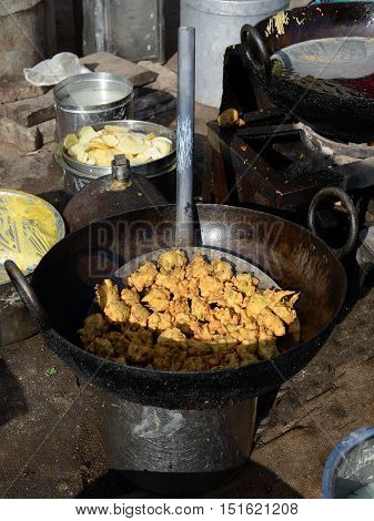 Plain Indian snacks fried in deep oil sold in the street